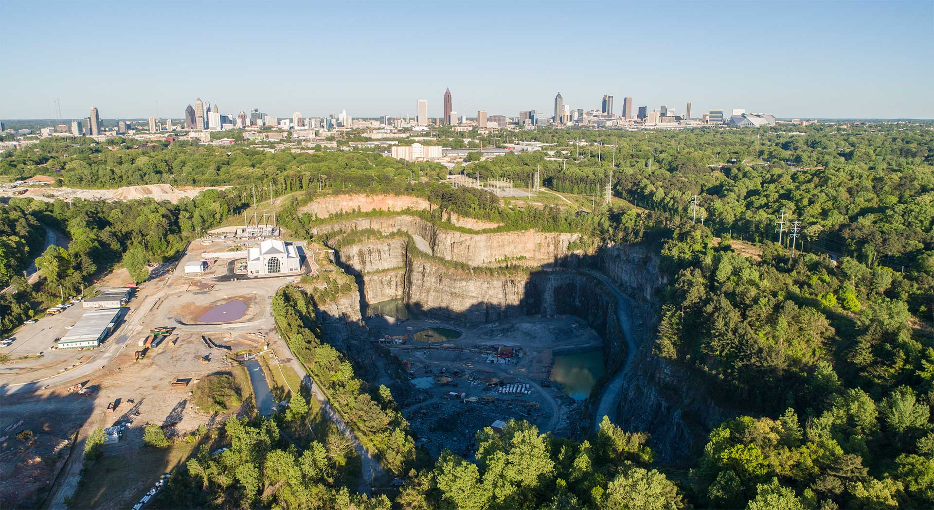 Birdseye view of Atlanta and stone quarry and city skyline.