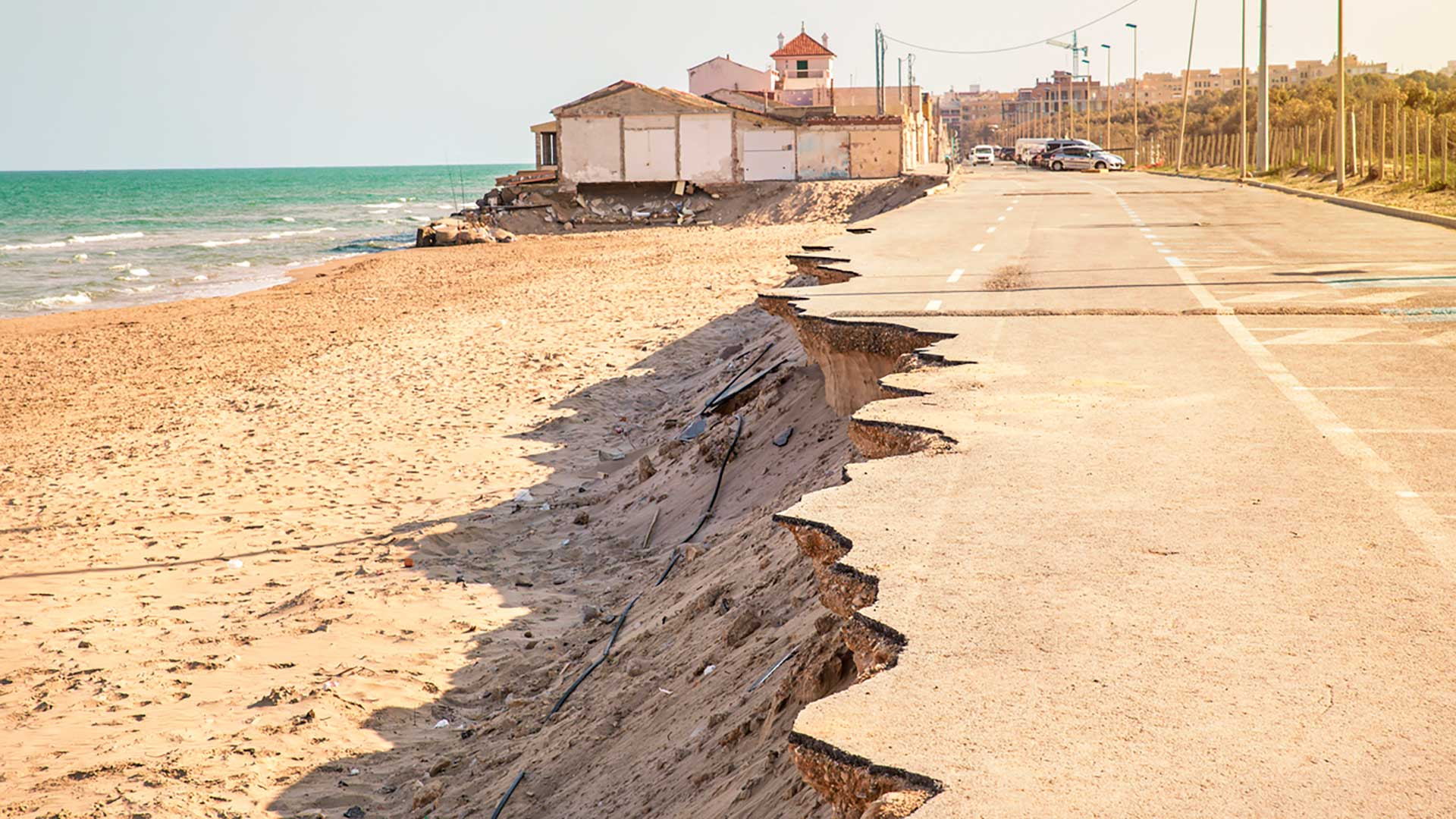 Beachfront highway erodes into the sand.